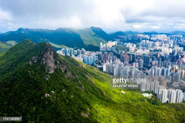 drone view of lion rock in hong kong with the city background - kowloon peninsula stock pictures, royalty-free photos & images