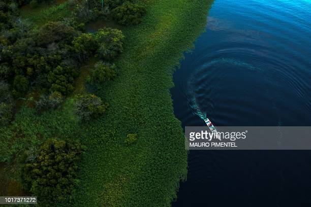 TOPSHOT Drone view of Mamiraua Institute and WWFBrazil researchers working in the area of Maciel Lake at Mamiraua Sustainable Development Reserve in...