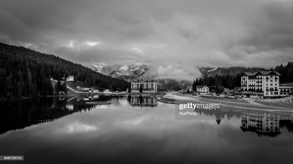 Image has been converted to black and white.) A drone view of Misurina Lake, in Misurina, Italy, on September 13, 2017. Lake Misurina is the largest natural lake of the Cadore and it is 1,754 m above sea level, near Auronzo di Cadore (Belluno).