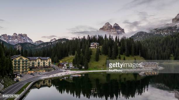 A drone view of Misurina Lake with the background the Tre Cime di Lavaredo in Misurina Italy on September 13 2017 Lake Misurina is the largest...
