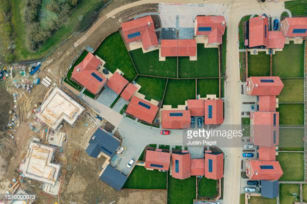 drone view of modern housing development in the uk - new stock pictures, royalty-free photos & images