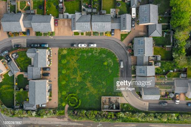 drone view of modern housing development in the uk - drone point of view stock pictures, royalty-free photos & images
