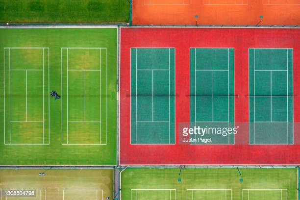drone view of multi coloured tennis courts - tennis tournament stock pictures, royalty-free photos & images