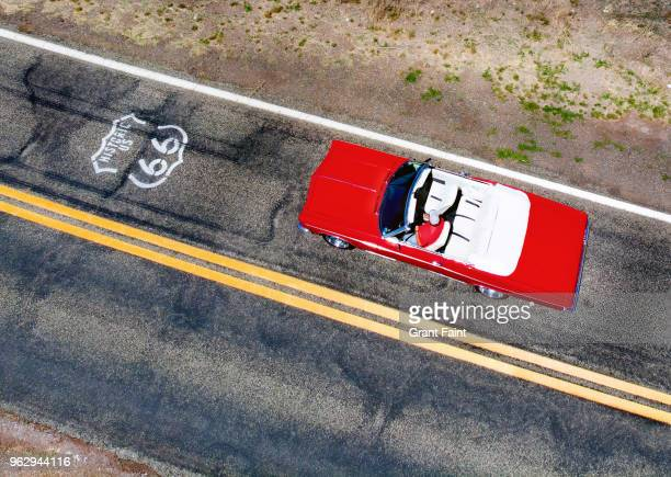 Drone view of red car driving famous road.