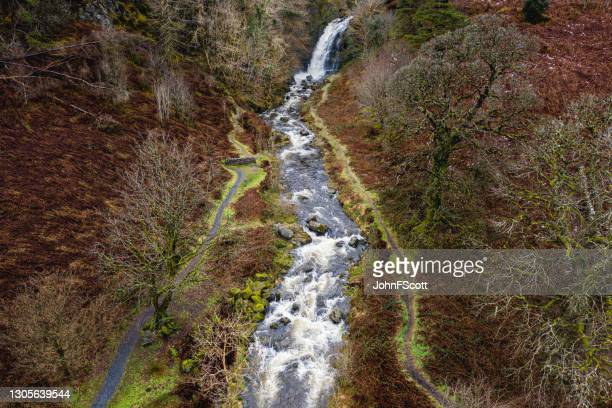 drone view of river and waterfall after heavy rain - johnfscott stock pictures, royalty-free photos & images