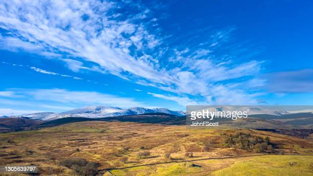 drone view of snow on distant hills during winter - johnfscott stock pictures, royalty-free photos & images