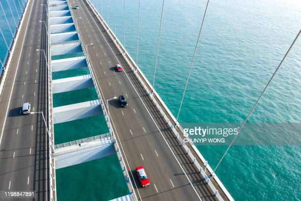 drone view of stonecutters bridge and the tsing sha highway - hong kong stock pictures, royalty-free photos & images