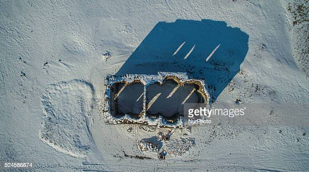 "Drone view of submerged church ""St. Ivan Rilski"" under heavy snow cover, near the town of Tvardica, east of the Bulgarian capital Sofia,..."