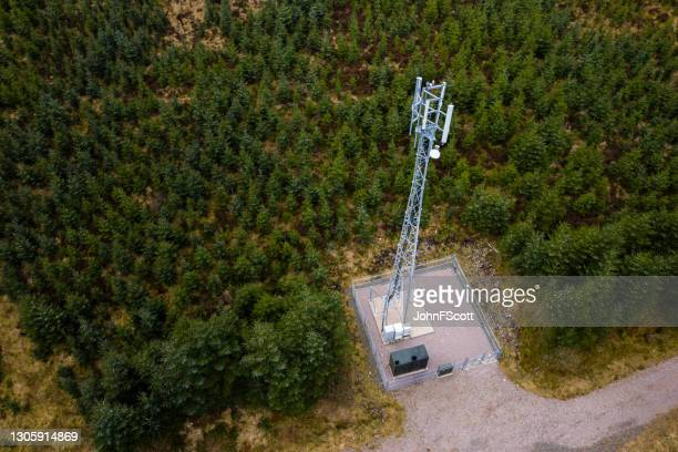 drone view of telecom mast in a rural setting - johnfscott stock pictures, royalty-free photos & images