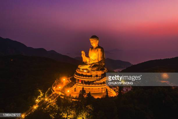 drone view of the big buddha is lit in the evening - third place stock pictures, royalty-free photos & images