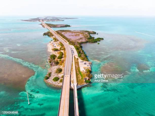 drone view of the overseas highway in florida keys with islands. - gulf coast states stock-fotos und bilder