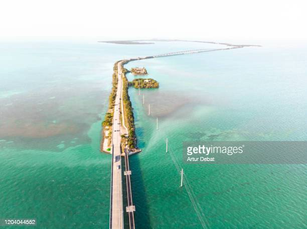 drone view of the overseas highway in florida keys with islands. - florida keys stock pictures, royalty-free photos & images