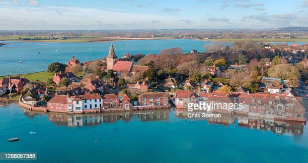 Drone view of the reflections in the water of houses on February 15,2019 in Bosham,England.
