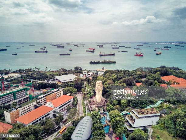 drone view of the sentosa merlion of singapore - merlion stock pictures, royalty-free photos & images