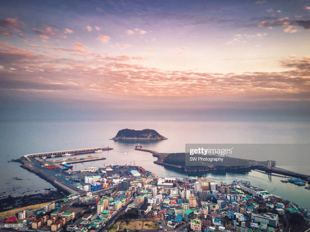 Drone view of the Seogwipo city on Jeju island, South Korea : Stock Photo