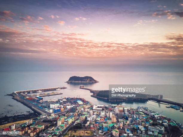 drone view of the seogwipo city on jeju island, south korea - jeju stock photos and pictures