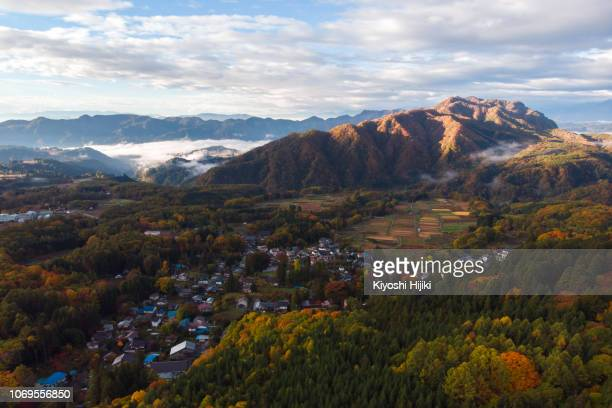 drone view of togakushi village in autumn in nagano, japan - 長野県 ストックフォトと画像