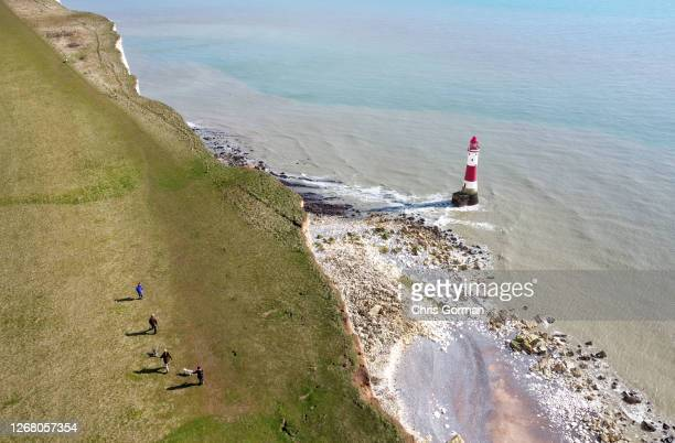 A drone view of tourists getting very close to the edge on March 62020 at Beachy HeadEngland