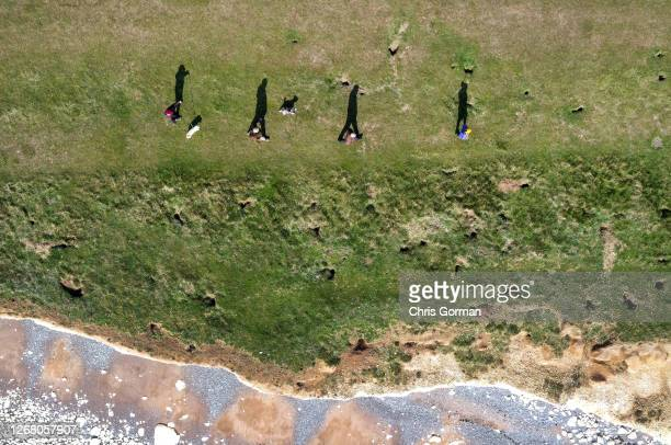 Drone view of tourists getting very close to the edge on March 6,2020 at Beachy Head,England.