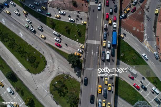 drone view of traffic on streets in city, bogota, columbia - vehículo terrestre fotografías e imágenes de stock