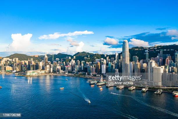 drone view of victoria harbour, hong kong - hong kong stock pictures, royalty-free photos & images