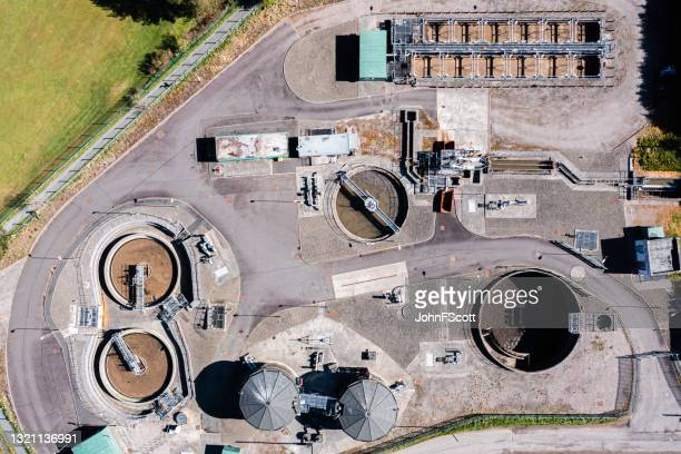 drone view of waste treatment plant - johnfscott stock pictures, royalty-free photos & images