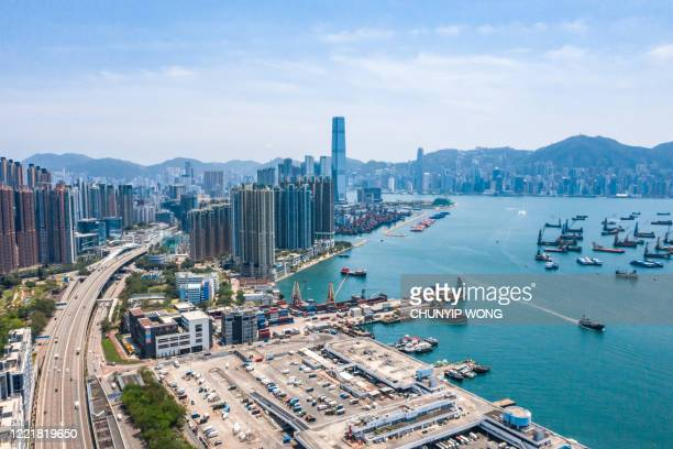 drone view of west kowloon, hong kong - passenger craft stock pictures, royalty-free photos & images