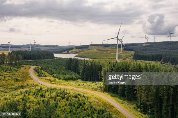 drone view of wind farm in brecon beacons - drone stock pictures, royalty-free photos & images