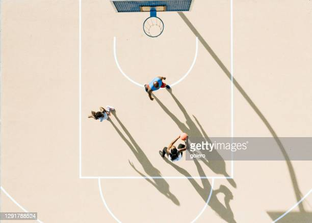 drone view on african family playing basketball together at hot sunny afternoon - basketball sport stock pictures, royalty-free photos & images