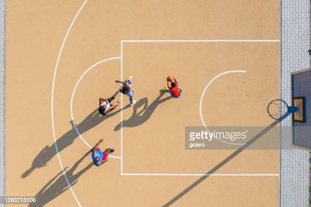 drone view on african family playing basketball together at sunny afternoon - court stock pictures, royalty-free photos & images