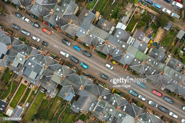drone view over street of victorian terraced housing - elevated view stock pictures, royalty-free photos & images