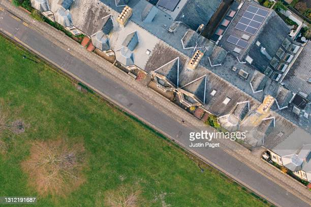 drone view over street of victorian terraced housing - victorian stock pictures, royalty-free photos & images
