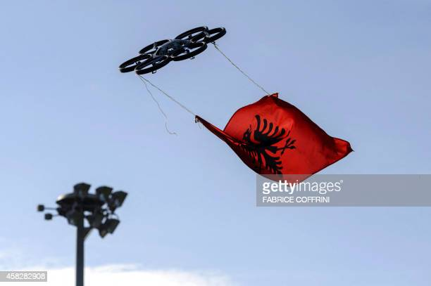 A drone with an Albanian flag is seen flying during a protest of Albanian football fan against UEFA at the European governing body's headquarters on...