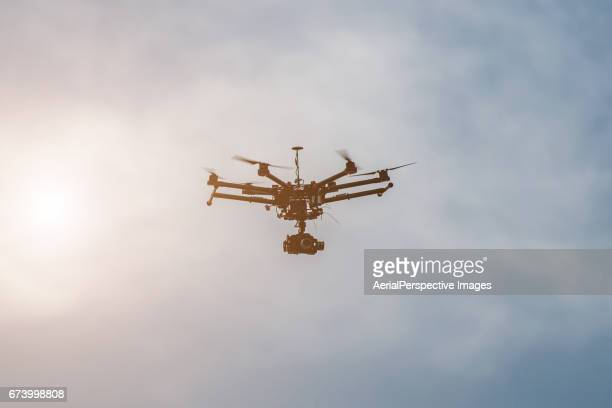 Drone with camera at sunset
