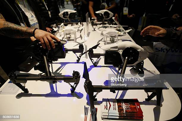 DJI drones are displayed during the 2016 Consumer Electronics Show in Las Vegas Nevada US on Wednesday Jan 6 2016 CES is expected to bring a range of...