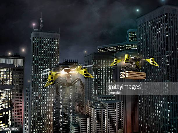 Drones delivering pizza in a city at night