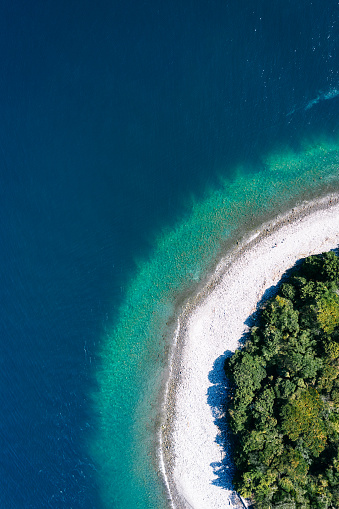 Drone's eye view of ring-shaped island with turquoise water - gettyimageskorea