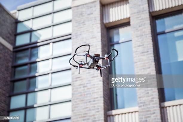 drones fly in cities. - drohne stock-fotos und bilder
