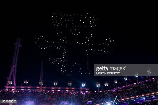 TOPSHOT Drones light up the sky in the shape of the Pyeongchang Winter Olympic Games mascot a white tiger named Soohorang during the closing ceremony...
