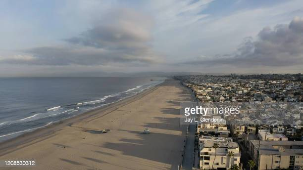 Drones view of Hermosa Beach, CA, looking north, as The Strand walking path and all beaches of Los Angeles county are closed in an effort to slow the...