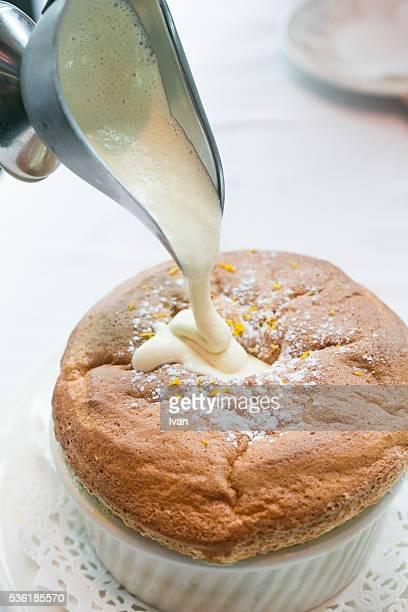 Drooping the Cream, Custard Sauce on Vanilla Orange Grand Marnier Souffle