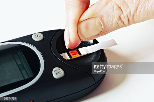 Drop of blood on test strip in glucometer