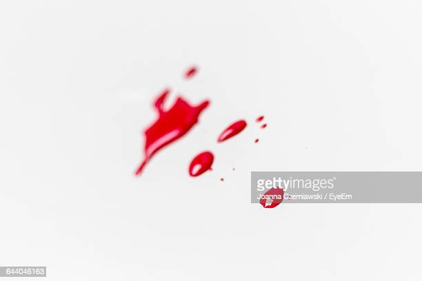 Drop Of Red Paint On White Background