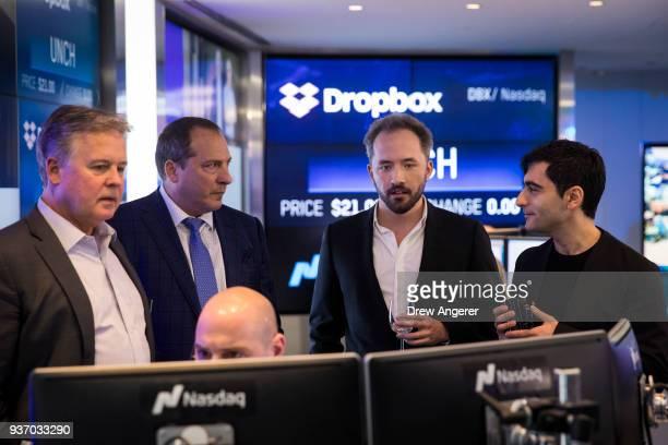 Dropbox CEO Drew Houston and Dropbox cofounder Arash Ferdowsi monitor computer screens as trading starts on Dropbox's initial public offering at...