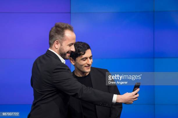 Dropbox CEO Drew Houston and Dropbox cofounder Arash Ferdowsi take a photo together before the launch of Dropbox's initial public offering at Nasdaq...