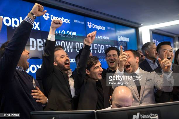 Dropbox CEO Drew Houston and Dropbox cofounder Arash Ferdowsi celebrate the launch of Dropbox's initial public offering at Nasdaq MarketSite March 23...