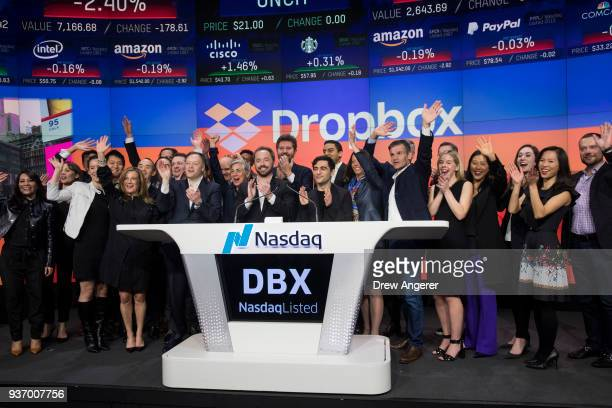 Dropbox CEO Drew Houston and Dropbox cofounder Arash Ferdowsi celebrate the launch of Dropbox's initial public offering as they ring the opening bell...