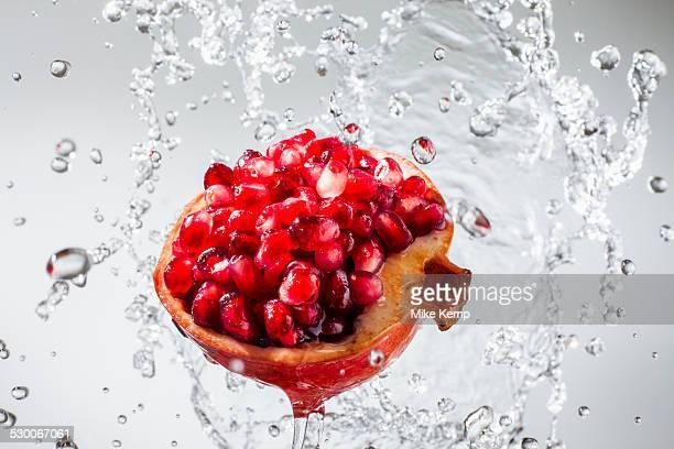Droplets splashing on pomegranate