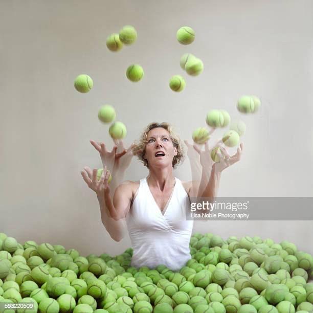 dropped balls: too many balls in the air - lisa strain stock pictures, royalty-free photos & images
