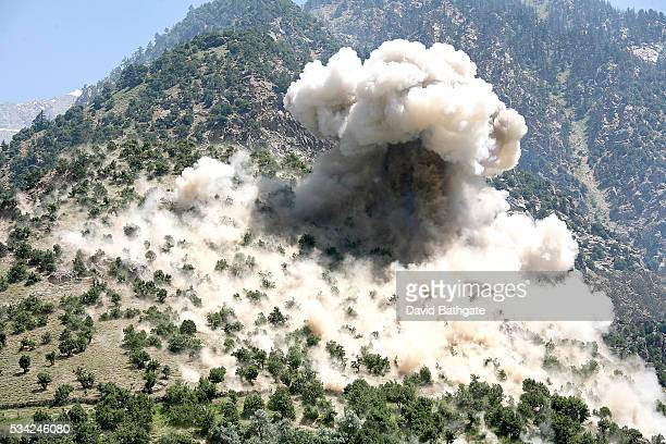 Dropped from a US Air Force F15 fighter jet a 2000pound bomb explodes on a Taliban fighting position near the town of Barge Matal When the 10th...